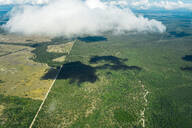 Aerial view of a road crossing the forest in Queensland, Australia - GEMF02999