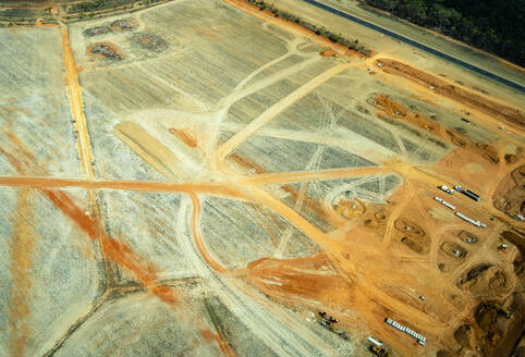 Aerial view of a quarry with trucks moving orange sand in Queensland, Australia - GEMF03008