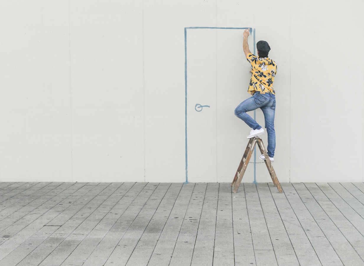 Digital composite of young man drawing a door at a wall - UUF18356 - Uwe Umstätter/Westend61