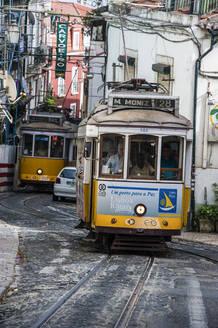 Tram passing through old town street of Alfama, Lisbon - RUN02879
