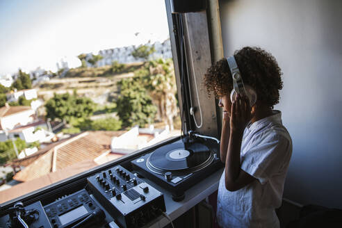 young dj with vinyl records - LJF00559