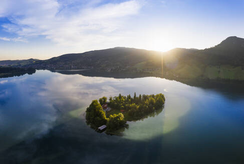 Scenic view of Worth island and Lake Schliersee against sky during sunrise - SIEF08831