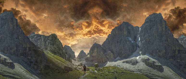 Caucasian hiker walking by remote mountains, Dolomites, Trento Alto Adige, Italy - BLEF12700