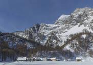 Rural village under snowy mountains - BLEF12703