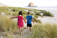 Caucasian children walking on beach - BLEF12763