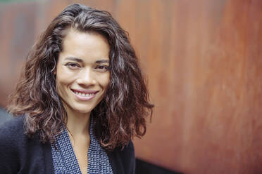 Mixed race businesswoman smiling - BLEF12790