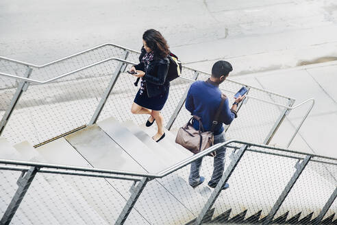 People using cell phones on city steps - BLEF12808