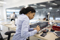 Female engineer assembling solar panel - HEROF37351