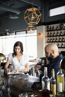 Couple wine tasting in wine bar - HEROF37558