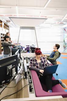 Creative business people working in open plan office - HEROF37735
