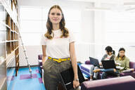 Portrait confident creative businesswoman in office lobby - HEROF37840
