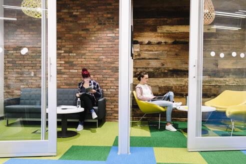Creative businesswomen working in coworking space - HEROF37888
