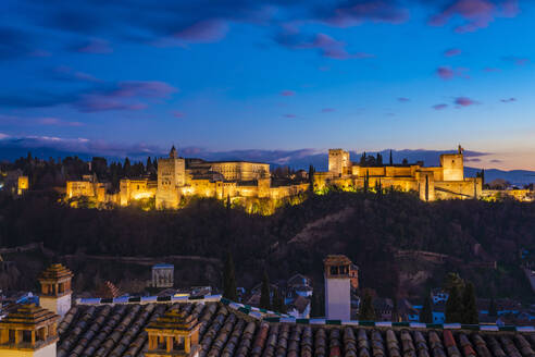 View of Alhambra with Sierra Nevada in the background at sunset, Granada, Spain - TAMF01874