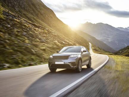 Sports Utility Vehicle on high alpine road, Timmelsjoch, Tyrol, Austria - CVF01422