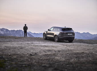 Man standing at lookout, Sports Utility Vehicle, Tyrol, Austria - CVF01425