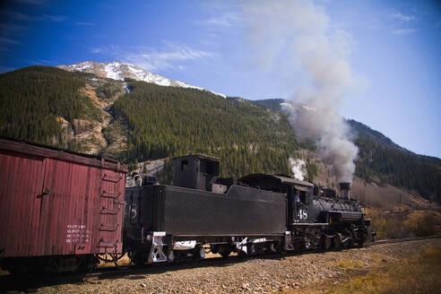 Steam train near mountain - BLEF13075