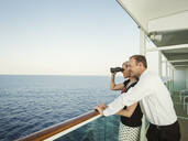 Caucasian couple admiring view from boat deck - BLEF13117