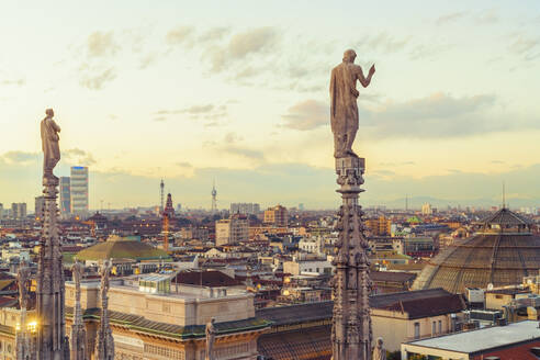 View of the statues on spires of Milan Cathedral at sunset, Italy - TAM01976