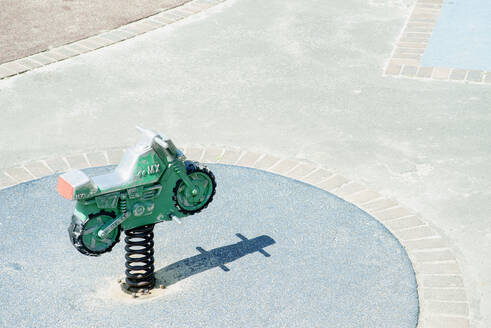 High angle view of toy motorcycle at playground - BLEF13196