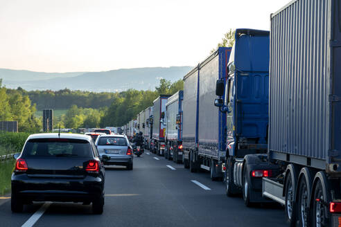 Rescue lane, cars and trucks during traffic jam in the evening, Germany - NDF00952