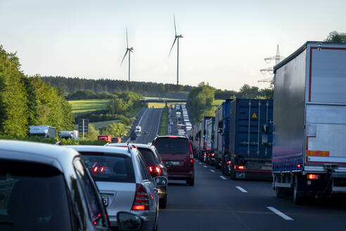 Rescue lane, cars and trucks during traffic jam in the evening, Germany - NDF00955