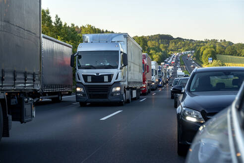 Rescue lane, cars and trucks during traffic jam in the evening, Germany - NDF00958