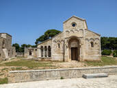Abbey of Santa Maria a Cerrate against clear blue sky during sunny day, Lecce, Italy - AM07233