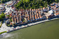 Aerial view of houses by Neckar River during sunny day, Hesse, Germany - AMF07236