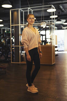 Portrait of young woman in a gym - SEBF00124
