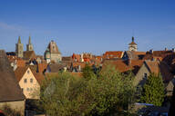 High angle view of houses and town hall tower in Rothenburg against blue sky, Bavaria, Germany - LBF02668