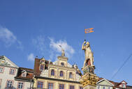 Low angle view of Roland Statue and Renaissance building against blue sky in Erfurt, Germany - GWF06192