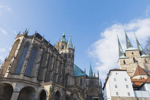 Low angle view of churches against blue sky in Erfurt, Germany - GWF06195