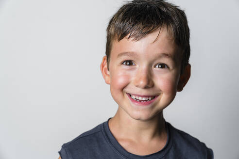 Portrait of strong boy, white background - MGIF00653