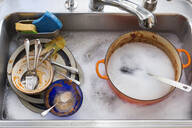 Kitchen sink full of dirty dishes - BLEF13472