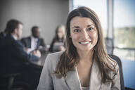 Businesswoman smiling in conference room - BLEF13556