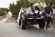 Friends having coffee together in truck bed - BLEF13607