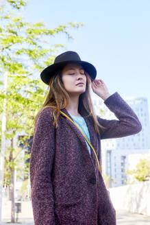 Dreamy woman wearing a hat, Barcelona, Spain - GEMF03083