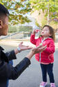 Father and little daughter playing with soap bubbles outdoors - GEMF03092
