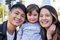 Portrait of happy parents with little girl - GEMF03095