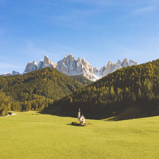 Scenic view of Odle mountain peaks and Chiesa di Santa Maddalena against sky, Italy - WPEF01675