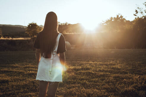Unrecognizable brunette girl in the field during sunset in Lleida - ACPF00574