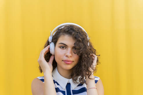 Portrait of young woman with headphones - AFVF03677