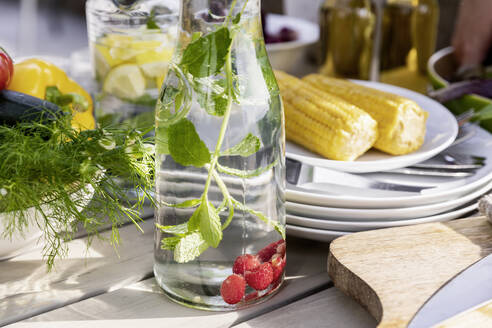 Detox infused water on garden table - FMKF05777