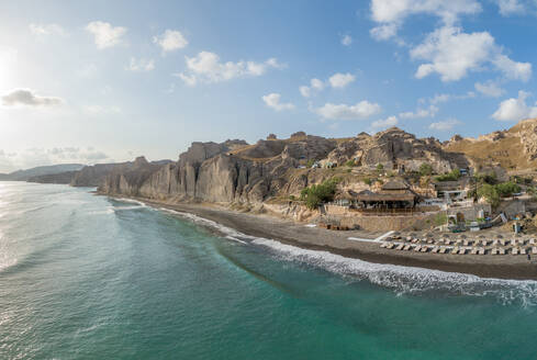 Panoramic aerial view of beach bar on the island of Santorini, Greece. - AAEF00483