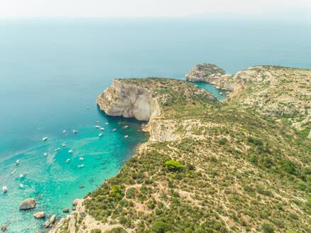 Aerial view of Sella del Diavolo rocky coast with yachts, Cagliari, Sardinia. - AAEF00753