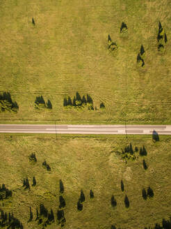 Aerial view of a en empty straight road in countryside of Estonia. - AAEF01005