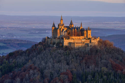 Hohenzollern Castle on top of mountain against sky, Germany - RUEF02311