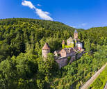 Zwingenberg Castle amidst trees against blue sky in town, Hesse, Germany - AMF07250