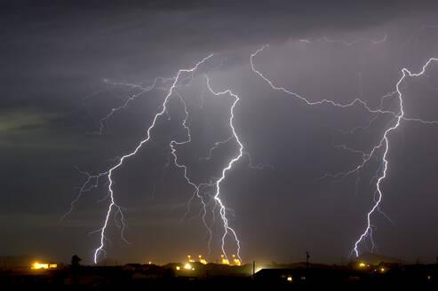 Multiple lightning bolts striking a power plant in Arlington during the 2016 monsoon season, Arizona, United States of America, North America - RHPLF00168