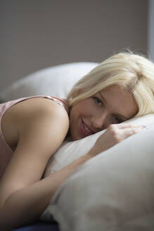Caucasian woman laying in bed - BLEF13749